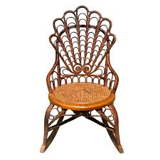 Vintage Boho Chic Ornate Rattan Rocking Chair With Cane Seat Havana Cane Sofa Cushion Vintage Birdseye Maple Rocking Chair Woven Seat Sewing Mid Century Danish Modern Rope Wegner Pair Of Chairs Rosewood Carved With Cane Weaving Vti Chennai Antique Woven Rocking Chair Butter Churn On Wooden Malawi White Mid Century Arthur Umanoff Cord Rope Wicker Rocker Rustic Primitive Armchair Glider Seating Rattan Shabby Chic Coastal Country French Nursery Old Wooden Isolated Stock Photo