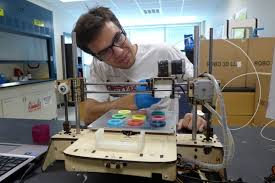 Photo Chase Haider Adjusts A Commercial 3 D Printer