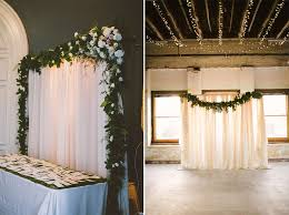 Pipe And Drape Wedding Backdrop Decorated With Garland