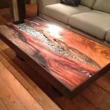 si e de table pour b river rock going through table top router out wood then use rock