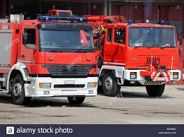 Two Truck Fire Engines Firefighters During A Fire Drill Training In ... The Front Part Of Two Trucks Different Styles Modern Free Photo Truck Vector Transport Creative Commons Xpo Logistics Signs Twoyear Deal With Renault Commercial Motor Lane Desktop Kinsmart Vs Hot Wheels 1999 Dodge Power Wagon 1913 Ertl Model Banks And Pepsi Co Toy Truck Bank Accident On M2 North Leaves Highway Obstructed Road Safety Blog Movers In Virginia Beach Va Two Men And A Truck Hsp Racing Hobby Car 110 Scale Electric 4wd Off Road Rock Crawler Mary Ellen Sheets Meet The Woman Behind Men A Fortune Way Sack Platform Vintage Six Wheeled Army Tow With Cranes Painted Two Fire Engines Refighters During Drill Traing