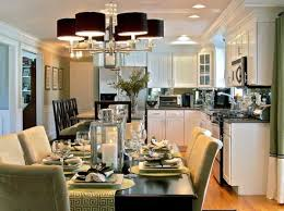 View In Gallery Chandelier With Black Lampshades Above Green Dining Space
