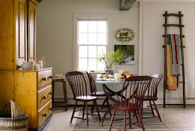 An Early American Hutch And English Apple Picking Ladder Create Bold Accent Colors