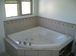 Tiling A Bathtub Surround by Furniture Home Cool Corner Soaker Tub With Wall Tile Surround And