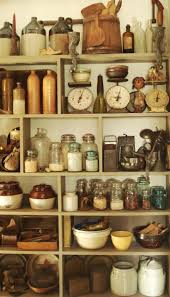 Crocks And Vintage Kitchen Items Such As Canning Jars Mashers Butter Paddles Molds Rolling Pins Fill This Make Shift Pantry