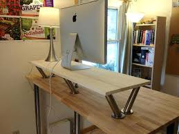 Ikea Desk Tops Uk by Showy Stand Up Desk Ikea Ideas Image Of A On Table With Laptop Top