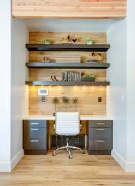 small office space with built in desk wood wall white leather