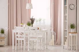 Lamp Above Table And White Chairs In Pink Dining Room Interior ... Pink Ding Chairs Modern Room Living Room Fniture Inspiration Ikea Awesome Velvet Chair Ottoman Blush Retro Diamond Back Brushed Kitchen Ipirations Design And Decorating For This Years Tov Fniture Rocco Tovd6187 Bright With White Plastic And Relax Space Stock Delta Children Princess Crown Kids Table Set With Storage How I Found My Dream New House Chairs Wooden Grey Bookshelf Tulips In