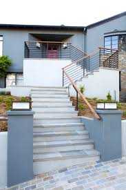 Rustic Modern House Design With Stone Wall Exterior And Mounted ... Best Granite Colors For Stairs Pictures Fascating Staircase Interior Design Handrails With White Wood Railing And Steps Home Gallery Decorating Ideas Garage Deck Exterior Stair Landing Front Porch Designs Minimalist House The Stesyllabus Modern Staircase Ideas Project Description Custom Design In Prefab Concrete Homes Good Small Designed Outside Made Creative 47 Wooden Images
