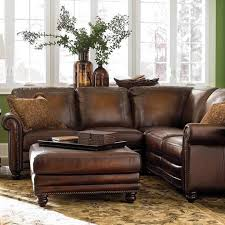 living room brown leather sectional sleeper sofa plus ottoman on