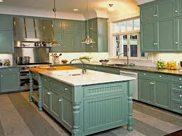 Luxury Kitchen Design With Matte Green Cabinet Also Beautiful Flooring And Gorgeous Vent Hood Designs Besides Large Island Spacious