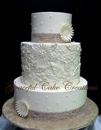Rustic Chic Ivory Butter Cream Wedding Cake With A Fondant Floral Applique Burlap And Lace