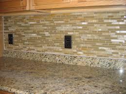 simple kitchen with brown glass subway tile backsplash black