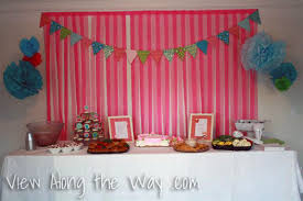 Strips Of Crepe Paper Behind The Food Table At A Baby Shower Or Birthday Party
