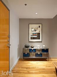 The Entrance Foyer Is An Ideal Space For Displaying Art And Features A Decorative Sideboard Recessed Lighting Which Lend Exaggerated Sense Of