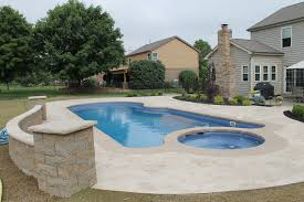Home Pool with Stamped Concrete Pool deck and large custom stairs