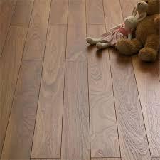 eurohome narrow plank walnut laminate flooring at homebase co uk