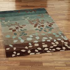 Create blue and brown area rugs in home