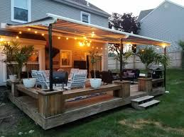 Shield Your Deck From The Elements With A Retractable Pergola ... Outdoor Marvelous Retractable Awning Patio Covers For Decks All About Gutters Deck Awnings Carports Rv Shed Shop Awnings Sun Deck A Co Roof Mount Canopy Diy Home Depot Ideas Lawrahetcom For Your And American Sucreens Decor Cozy With Shade Pergola Design Magnificent Build Pergola On Sloped Shield From The Elements A 12 X 10 Sunsetter Motorized Ers Shading San Jose