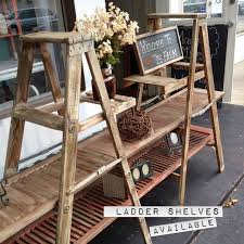 Display Shelves Created With Shutter Doors And Ladders