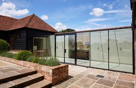 Frameless Structurally Glazed Walkway Link Between Converted Barn ... Wonderful Kitchen With Barn Cversions Design Combined Wooden Affordable Pole Barns Converted To Homes Simple Cversion Guide Homebuilding Renovating Scheune A Reason Why You Shouldnt Demolish Your Old Just Yet Dairy Into An Eco Home Filled Rustic Charm Lovely Living Room Ideas 17 In With Modern Barn Cversion Real Door Closes On Cversions As Builders Are Put Off By Grand Cheap Metal That Has Materials