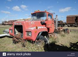 An Old Red Mack Truck In A Vehicle Graveyard Stock Photo: 145901452 ...