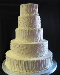 """More and more brides are asking for a """"rough"""" buttercream finish on their cakes This particular cake was unique because the bride wanted to bine this"""