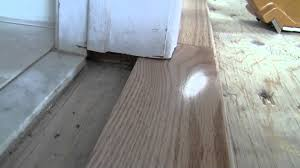 Transition Strips For Laminate Flooring To Carpet by Hardwood Bathroom Transition How To Video Youtube