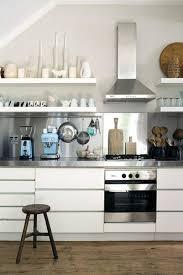Stainless Steel Kitchen Appliances And Backsplash Design