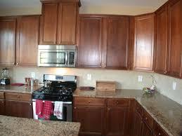 Hickory Wood Honey Lasalle Door Hampton Bay Kitchen Cabinets Backsplash Pattern Tile Composite Soapstone Countertops Sink