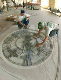 Workers From Port Morris Tile And Marble Install The BU Seal In