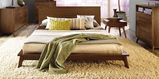 Bed Frame Types by Yellow Textured Carpet And Low Height Wooden Modern Queen Bed