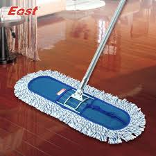 Electric Broom For Wood Floors by Stock Photo Sweeping Dust On Wood Floor Closeup Broomstick And