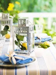 Summer Sweetness Beachy Colors Of Blue And Yellow Take To The Porch In This Summertime Setting Silver Lanterns Add Sparkle But For A Spark Surprise