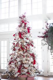 Snow Flocking For Christmas Trees by Flocked Christmas Tree With Red Decorations Flocked Christmas