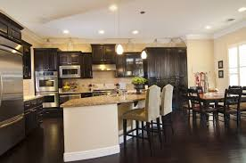 This Fantastic Kitchen Has A Sleek Dark Wooden Floor The Cabinets In Space Correspond