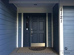 Front door painted Benjamin Moore Hale Navy blue siding and white