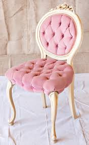 the luxurious feel of these pink and gold chairs is spot on