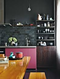 Black Tile With Dark Grout Grounds Other Adjacent Colors For This Berlin Bachelor Pad The Noir Ish Hue Toughens Up Even A Bubblegum Pink Cabinet Color
