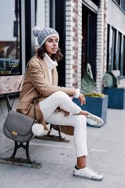 Annabelle Fleur Breaks Up An All White Outfit With A Trendy Camel Coat And