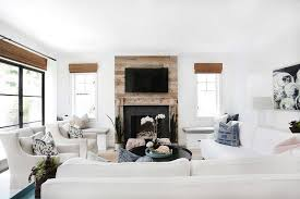 fireplace between window seats transitional living room