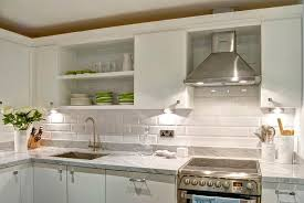 white flat front kitchen cabinets with gray marble countertops