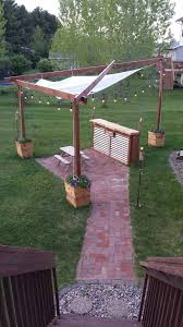 Brick Patio, Cedar Planter Boxes, Shade Sail, String Lights, Back ... Amazoncom Tiki Brand 12 Oz Torch Replacement Canister 57 In Kauai Bamboo Torch1112478 The Home Depot Outdoor Mini Tiki Torches Citronella Tabletop Thatch Roof Kits For Deck How Make Hut Palm Leaf Roof Backyards Enchanting Backyard Sets Patio Materialsfor Nstructionecofriendly Building Interior Henderson House Rental Tropical Themed Dual Master Suite Since It Seems To Be Garden Showoff Season Tikinew Orleans Royal Polynesian Set Of 4 Walmartcom Grenada Torch1116081