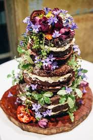 Beautiful Tiered Rustic Wedding Cake With Vibrant Wildflowers