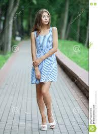 spring beautiful woman in summer dress posing in green park