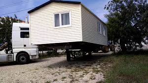 A fabricated steering axle trailer for mobile home transport