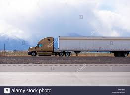 Side View Of Brown Big Rig Semi Truck Fleet Transporting Cargo In ...