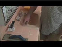 grouting help how to repair grout around the kitchen sink