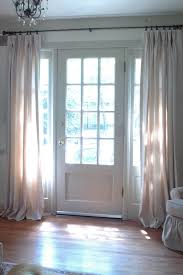 more hanging curtains by the front door only if curtains could be