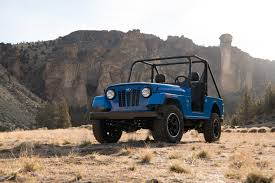 How Much Does The Mahindra Roxor Cost? We Compare It With The ... 2018 Jeep Gladiator Price Release Date And Specs Httpwww 2017 Jk Scrambler Truck Is Official Jeep Truck Youtube Wrangler Pickup Interior And Exterior Powertrack 4x4 Tracks Manufacturer Ut Trucks For Sale New Dodge Chrysler Autofarm Cdjr The Bandit Is The 700hp Hemipowered Pickup Of Our Dreams For 100 This Custom 1994 Cherokee A Good Sport News Performance Towing Capacity Engine